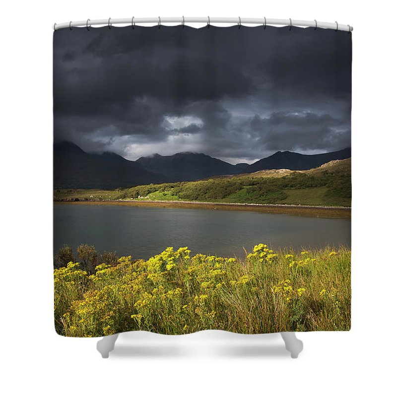 Tranquility Shower Curtain featuring the photograph Dark Storm Clouds Hang Over The by John Short / Design Pics
