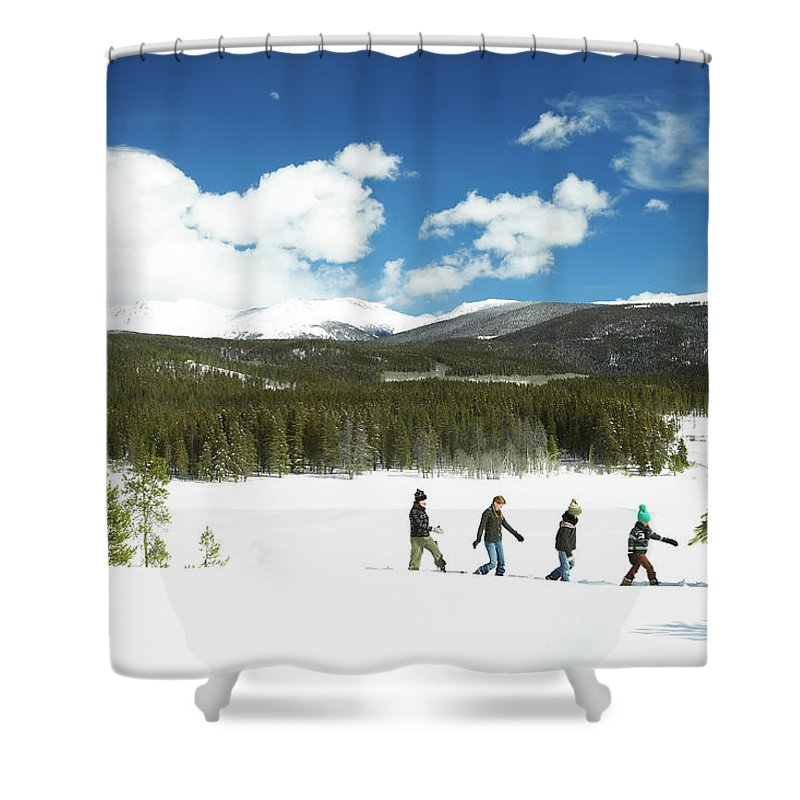 Three Quarter Length Shower Curtain featuring the photograph Family Carrying Christmas Tree In Forest by Thomas Northcut
