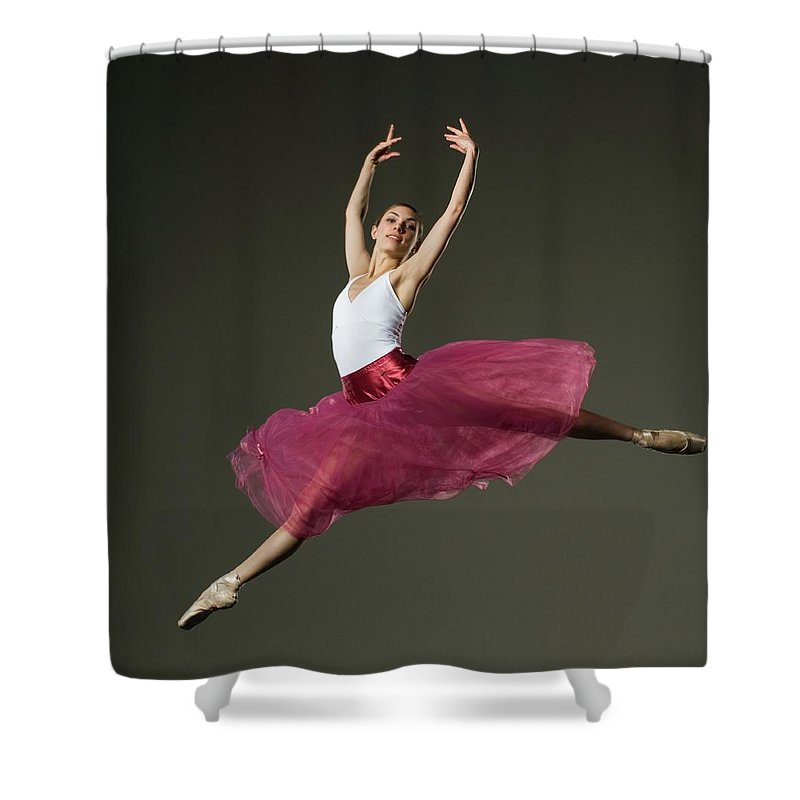 Ballet Dancer Shower Curtain featuring the photograph Female Ballet Dancer Jumping by Tetra Images - Erik Isakson
