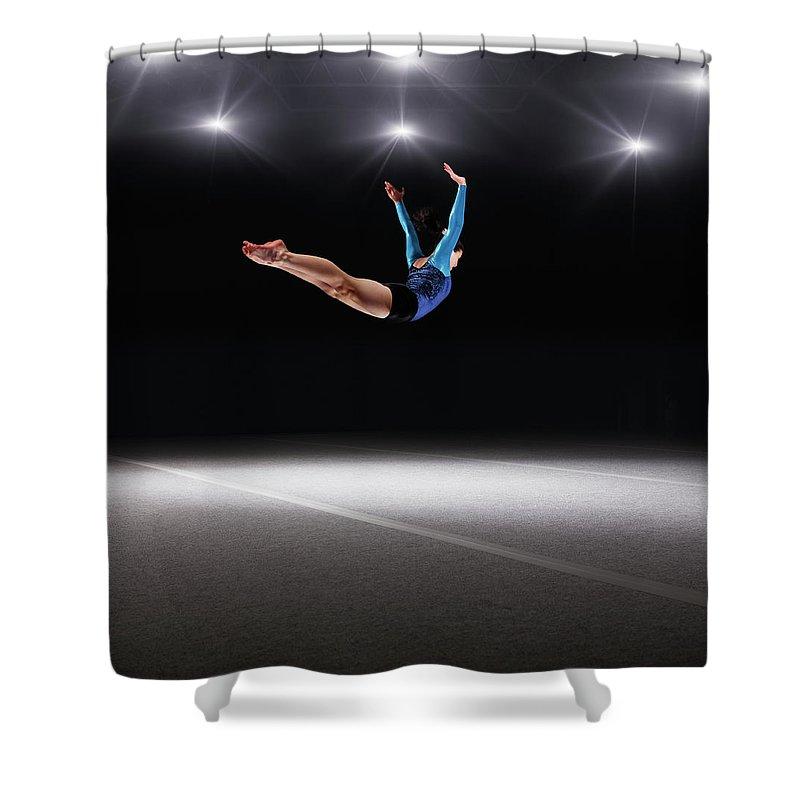 Human Arm Shower Curtain featuring the photograph Female Gymnast Jumping Through Air by Robert Decelis Ltd