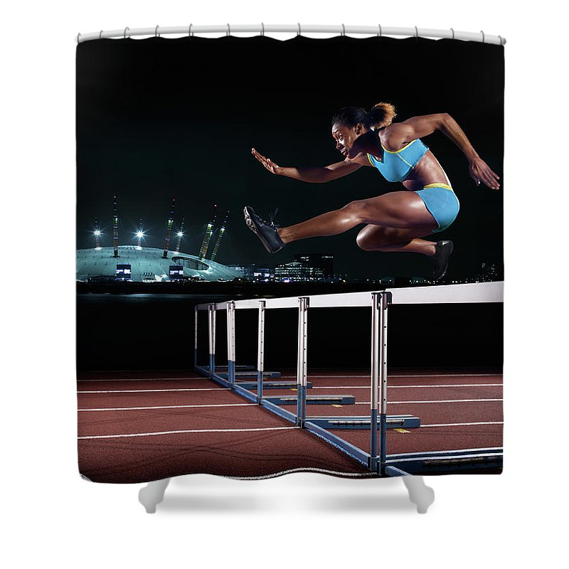 People Shower Curtain featuring the photograph Female Hurdling In London by Mike Harrington