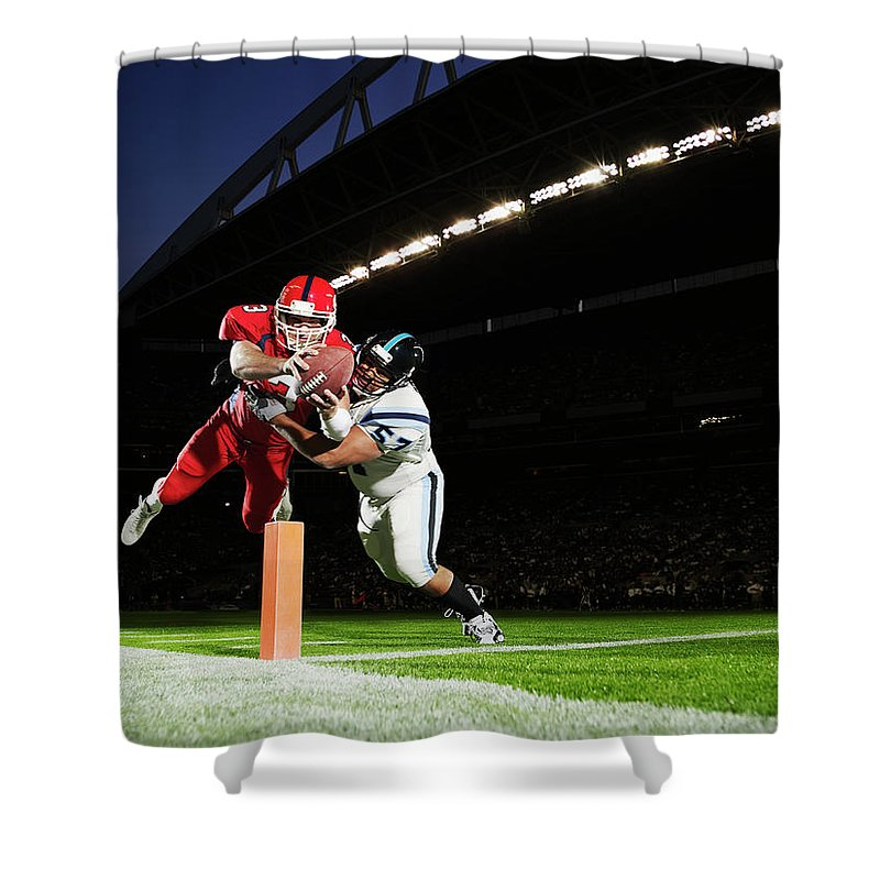 Sports Helmet Shower Curtain featuring the photograph Football Player Diving Into End Zone by Thomas Barwick
