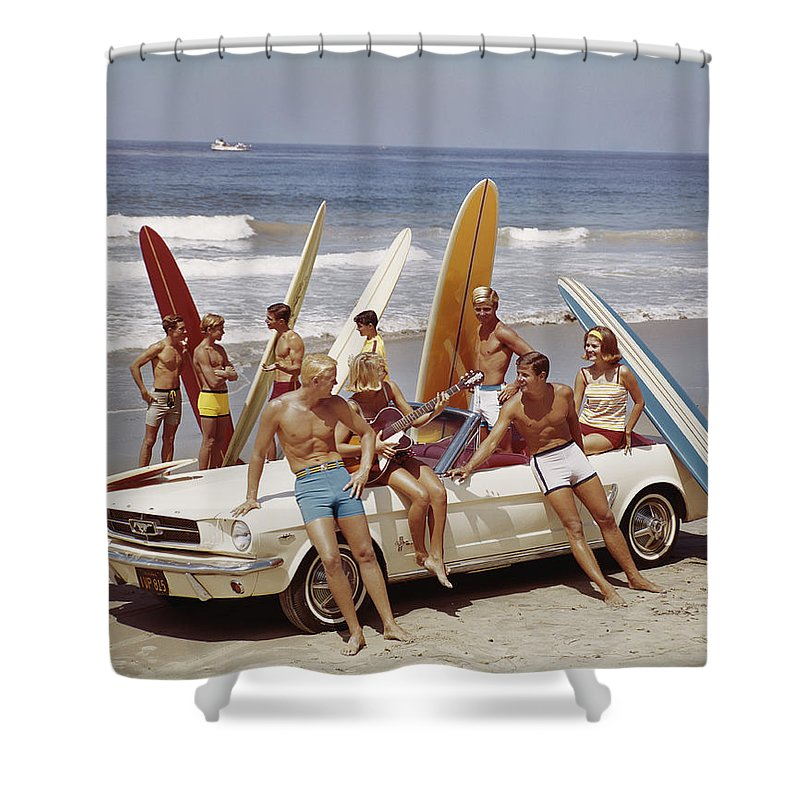Young Men Shower Curtain featuring the photograph Friends Having Fun On Beach by Tom Kelley Archive