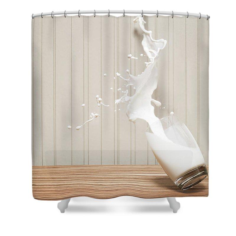 Milk Shower Curtain featuring the photograph Glas Of Milk Spilling by Henrik Sorensen