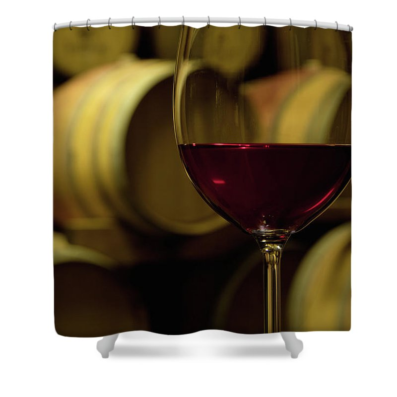 Stellenbosch Shower Curtain featuring the photograph Glass Of Red Wine In Wine Cellar by Siegfried Layda