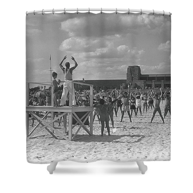 Human Arm Shower Curtain featuring the photograph Group Of People Exercising On Beach, B&w by George Marks