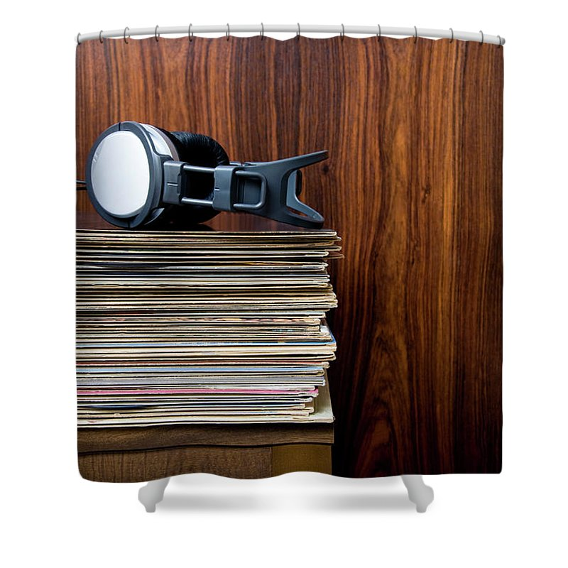 Technology Shower Curtain featuring the photograph Headphones Laying On Stack Of Vinyl by Steven Errico