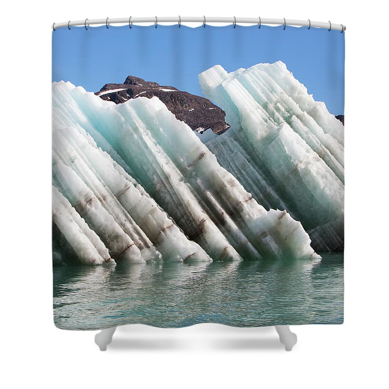 Iceberg Shower Curtain featuring the photograph Iceberg Streaked With Rock Debris by Anna Henly