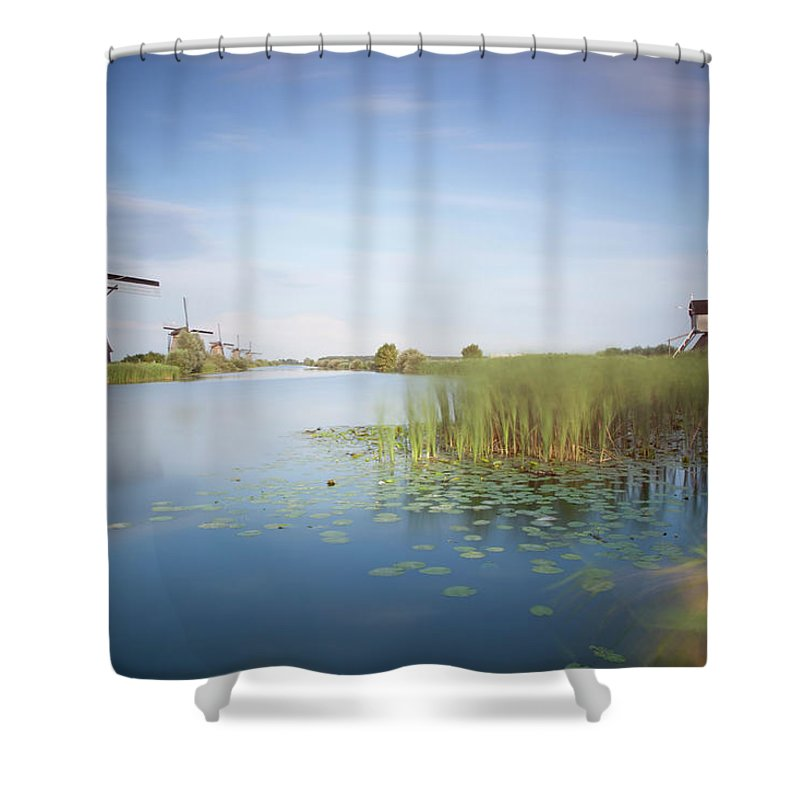 Tranquility Shower Curtain featuring the photograph Landscape With Windmills, Kinderdijk by Frank De Luyck