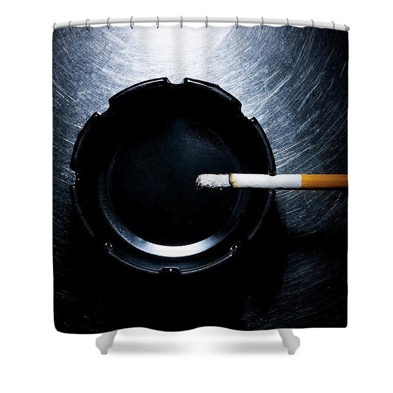 Part Of A Series Shower Curtain featuring the photograph Lit Cigarette And Ashtray On Stainless by Ballyscanlon
