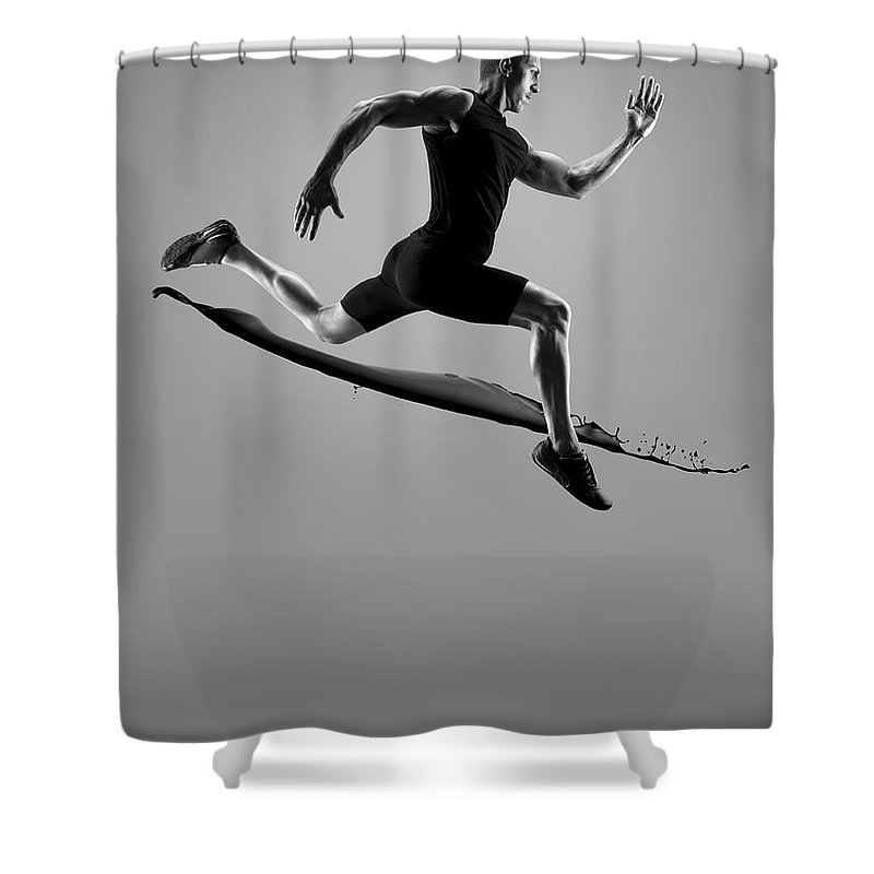 People Shower Curtain featuring the photograph Male Athlete Running Above Liquid Splash by Jonathan Knowles