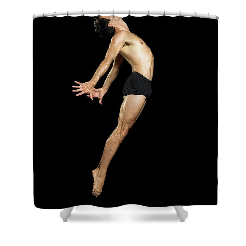 Human Arm Shower Curtain featuring the photograph Male Dancer Jumping by Image Source