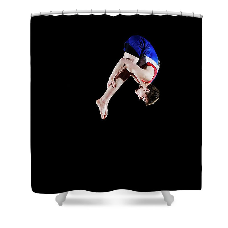 Focus Shower Curtain featuring the photograph Male Gymnast 16-17 Mid Air, Black by Thomas Barwick