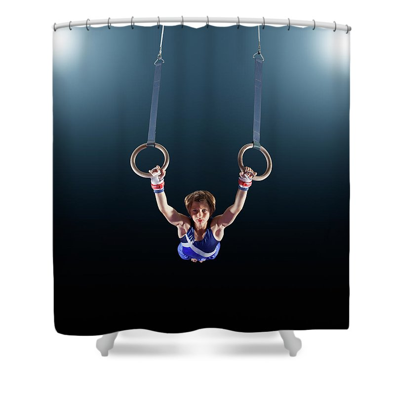 Focus Shower Curtain featuring the photograph Male Gymnast Performing On Rings by Robert Decelis Ltd