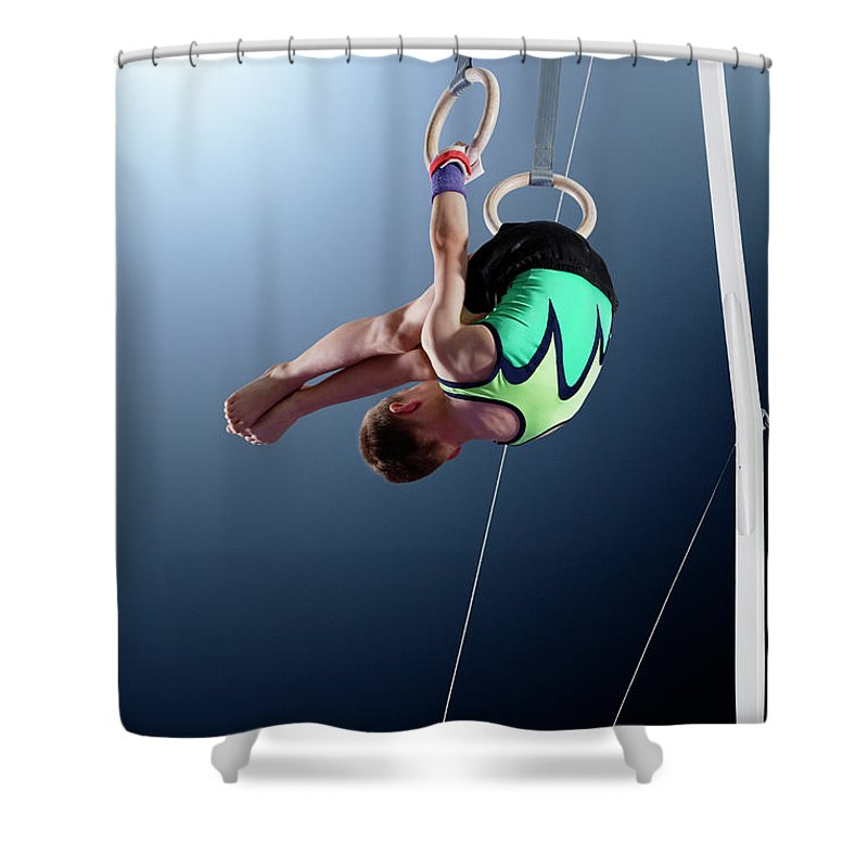Hanging Shower Curtain featuring the photograph Male Gymnast Performing Somersault On by Robert Decelis Ltd