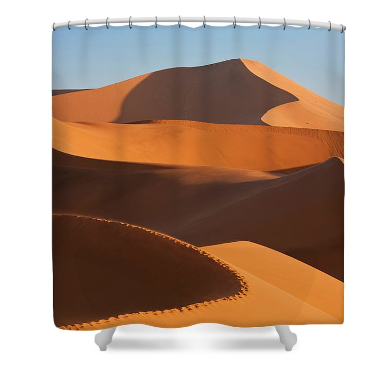 Shadow Shower Curtain featuring the photograph Man Climbing Sand Dunes, Namib Desert by Peter Adams