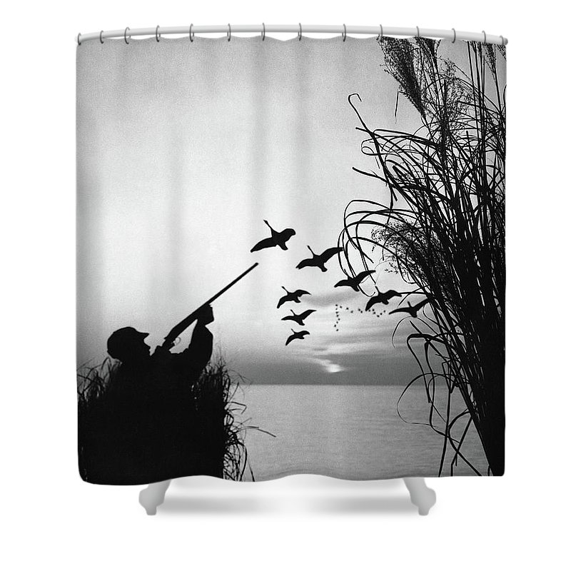 Rifle Shower Curtain featuring the photograph Man Duck-hunting by Stockbyte