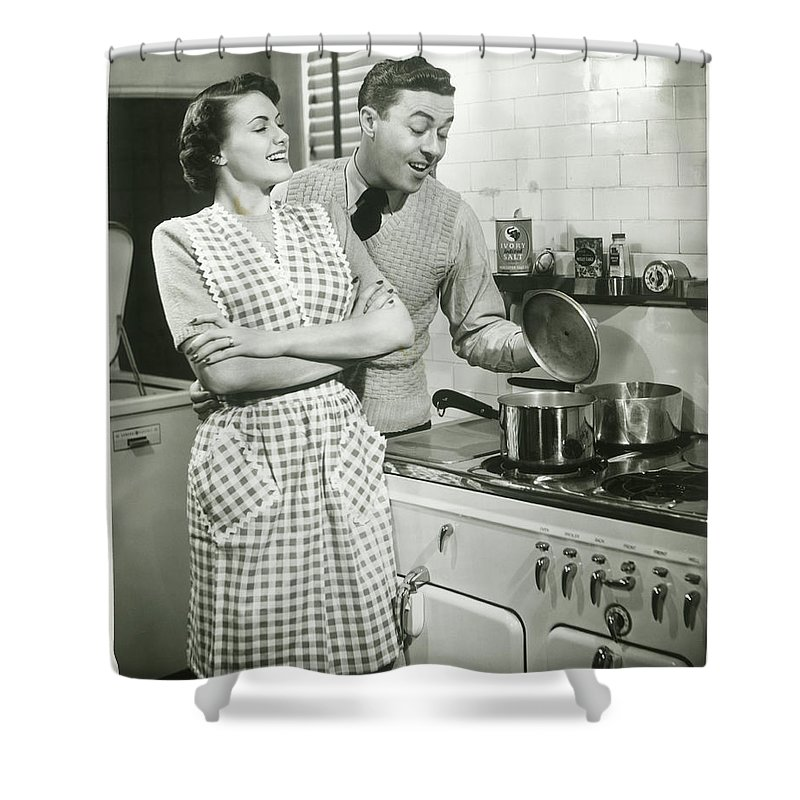 Heterosexual Couple Shower Curtain featuring the photograph Man Looking Into Pot In Domestic by George Marks