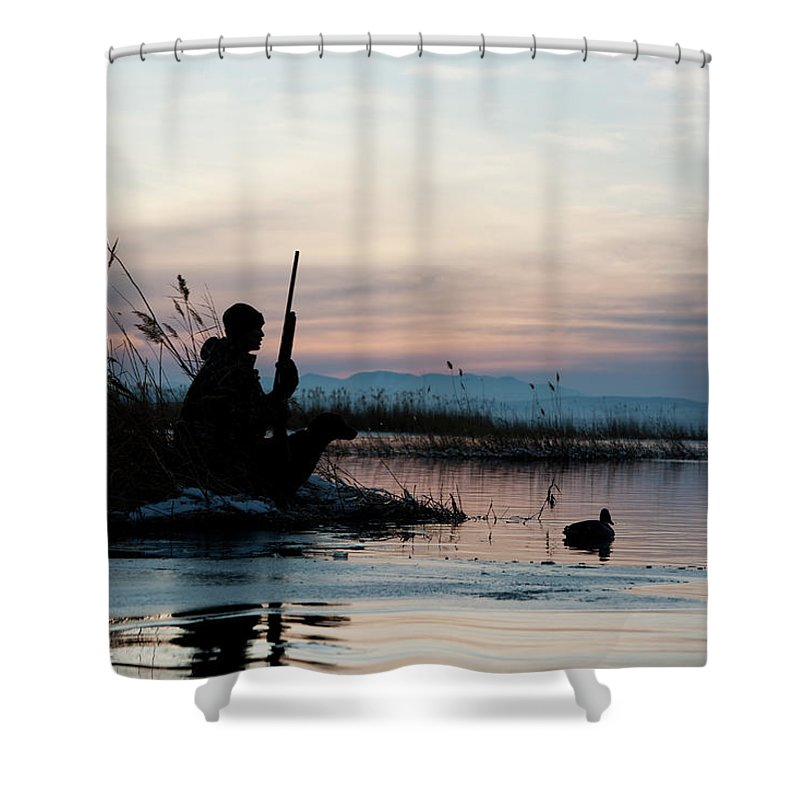 Rifle Shower Curtain featuring the photograph Man Out Hunting by Rubberball Productions