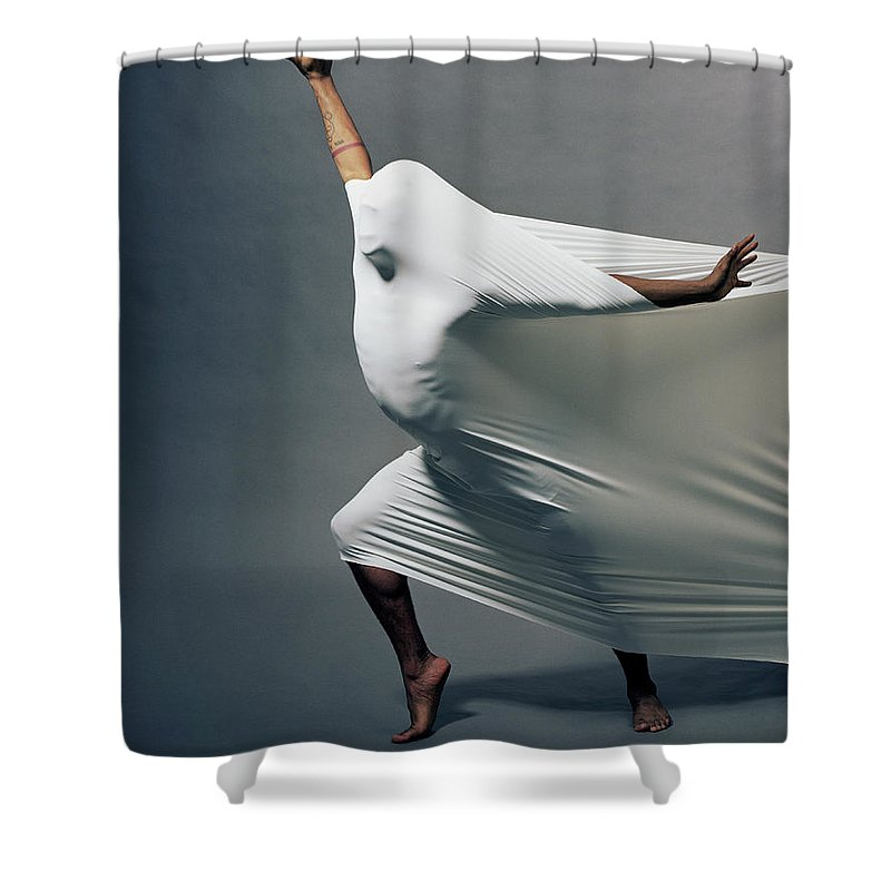 Hand Raised Shower Curtain featuring the photograph Man Pressing Into Fabric, Arms Extended by Pm Images