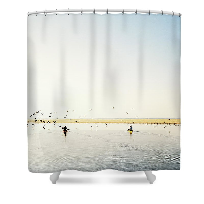 People Shower Curtain featuring the photograph Men Paddling Kayaks To The Beach by Julien Capmeil