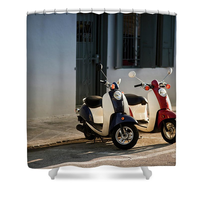 In A Row Shower Curtain featuring the photograph Motorbikes Parked On The Road by Pgiam