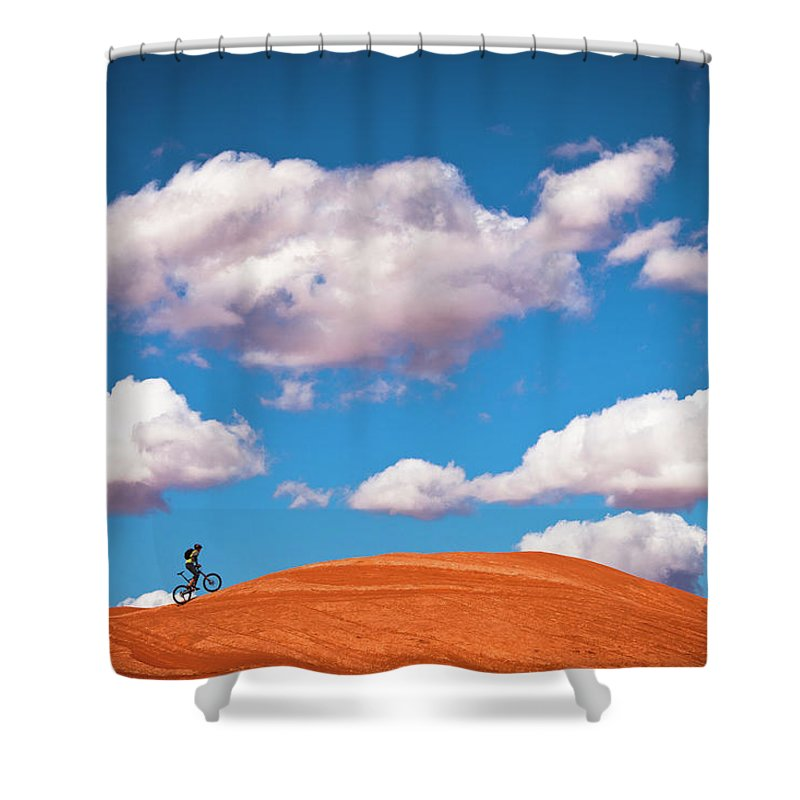Slickrock Trail Shower Curtain featuring the photograph Mountain Biker Climbing On Slick Rock by Visualcommunications
