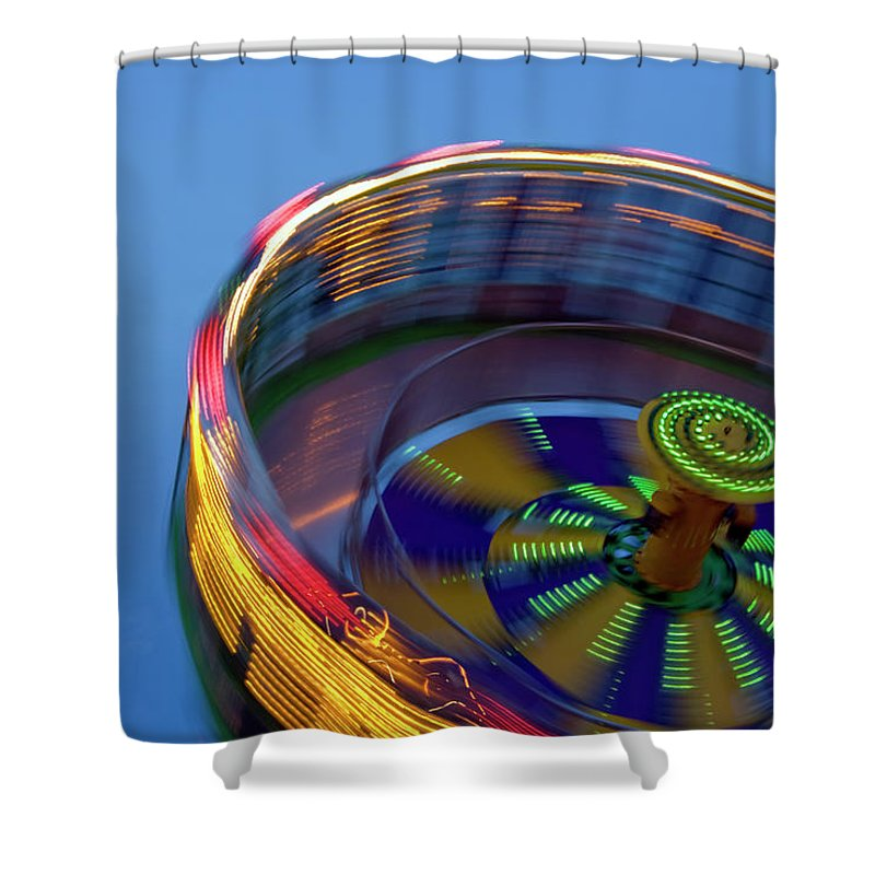 Carousel Shower Curtain featuring the photograph Multicolored Spinning Carnival Ride by By Ken Ilio