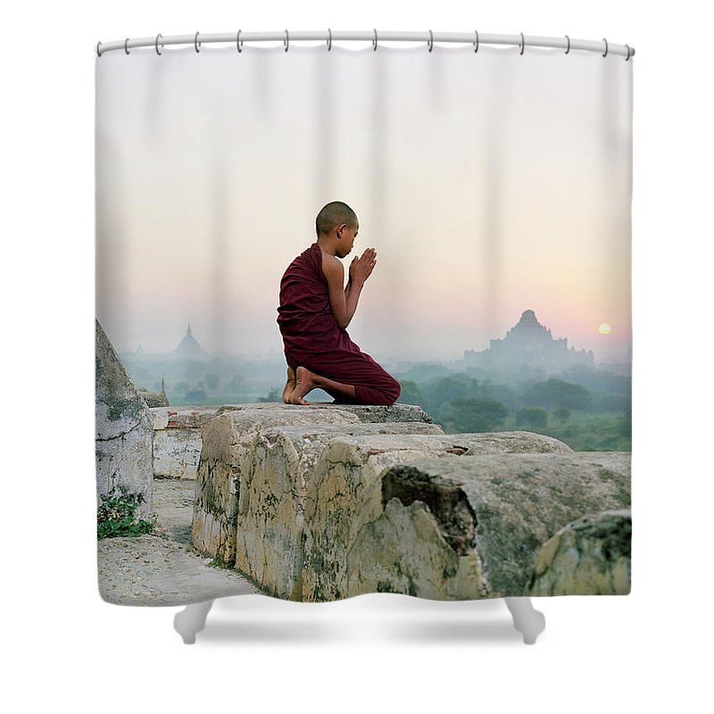 Child Shower Curtain featuring the photograph Myanmar, Bagan, Buddhist Monk Praying by Martin Puddy