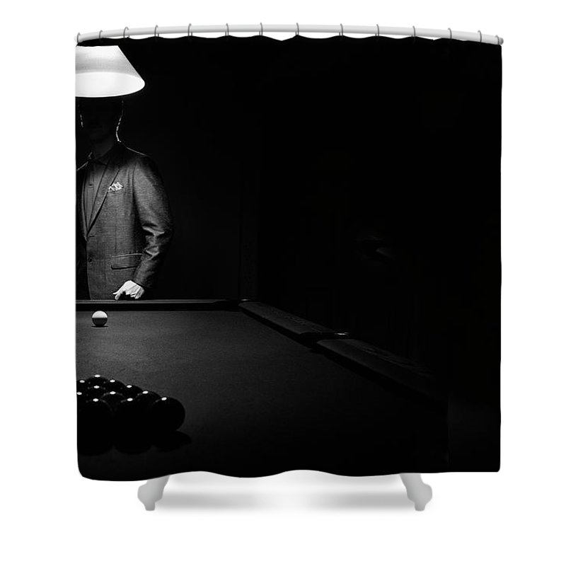 Mature Adult Shower Curtain featuring the photograph Mystery Pool Player Behind Rack Of by Design Pics / Richard Wear