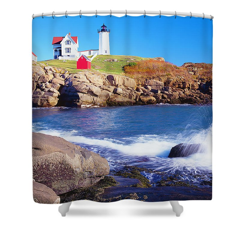 Water's Edge Shower Curtain featuring the photograph Nubble Lighthouse And Coastine Of Maine by Ron thomas