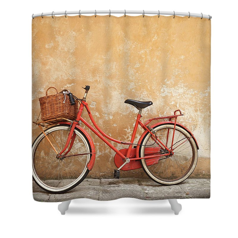 Leaning Shower Curtain featuring the photograph Old Red Bike Against A Yellow Wall In by Romaoslo