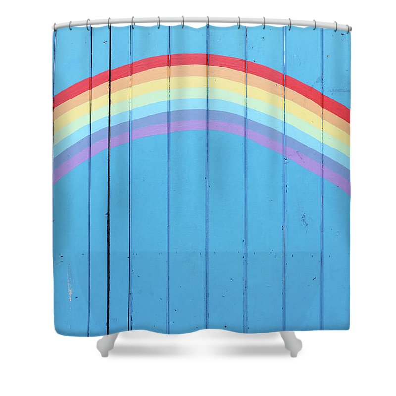 Art Shower Curtain featuring the photograph Painted Rainbow On Wooden Fence by Richard Newstead