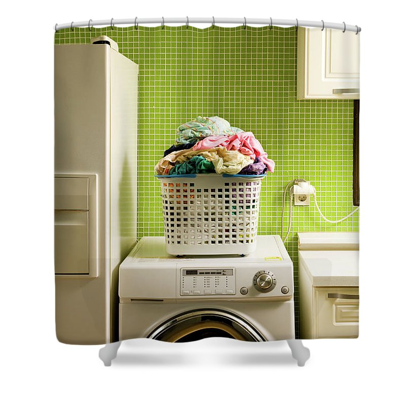 Washing Machine Shower Curtain featuring the photograph Pile Of Laundry On Washing Machine by Jae Rew
