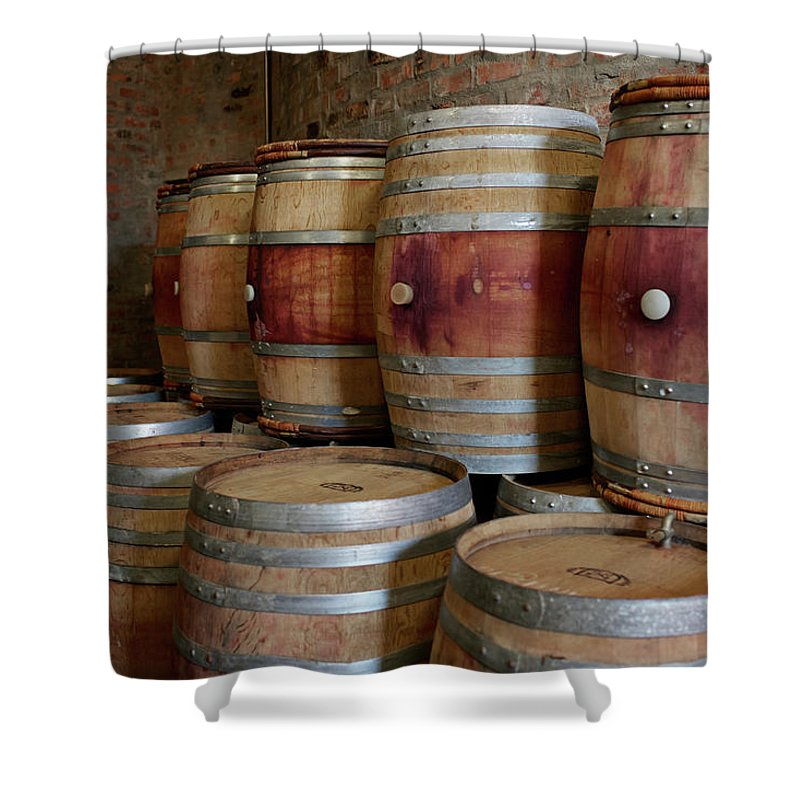 Stellenbosch Shower Curtain featuring the photograph Pile Of Wooden Barrels At Winery by Klaus Vedfelt