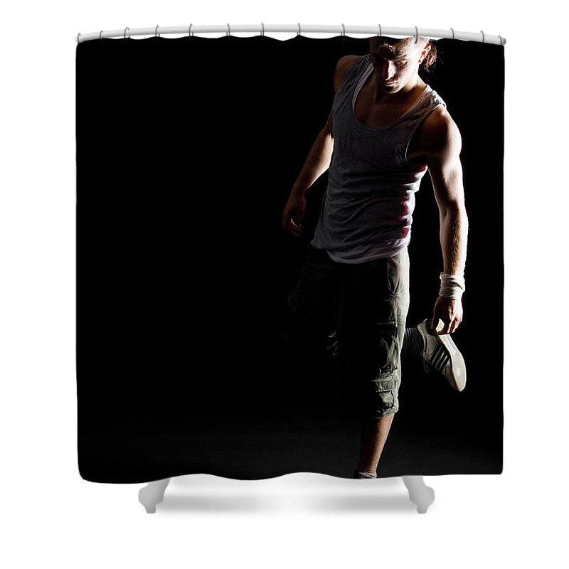 Cool Attitude Shower Curtain featuring the photograph Portrait Of A B-boy Stretching by Halfdark