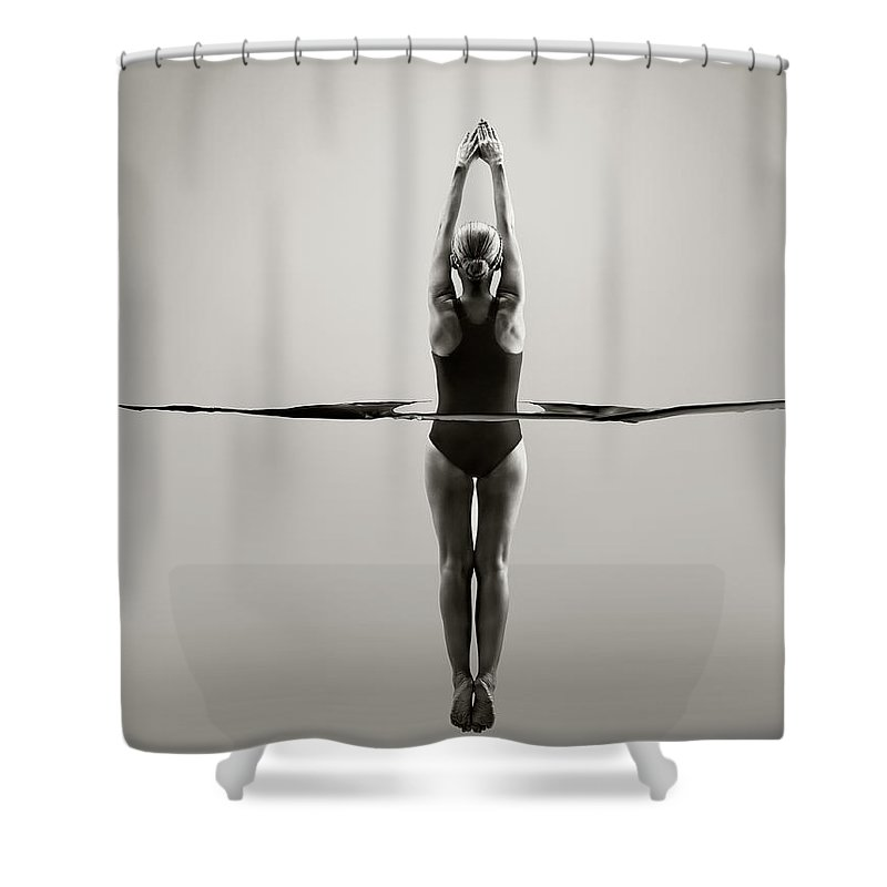 Diving Into Water Shower Curtain featuring the photograph Rear View Of Female Swimmer by Jonathan Knowles
