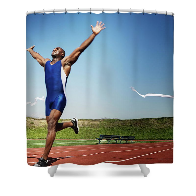 Human Arm Shower Curtain featuring the photograph Runner Crossing Finish Line by Jupiterimages