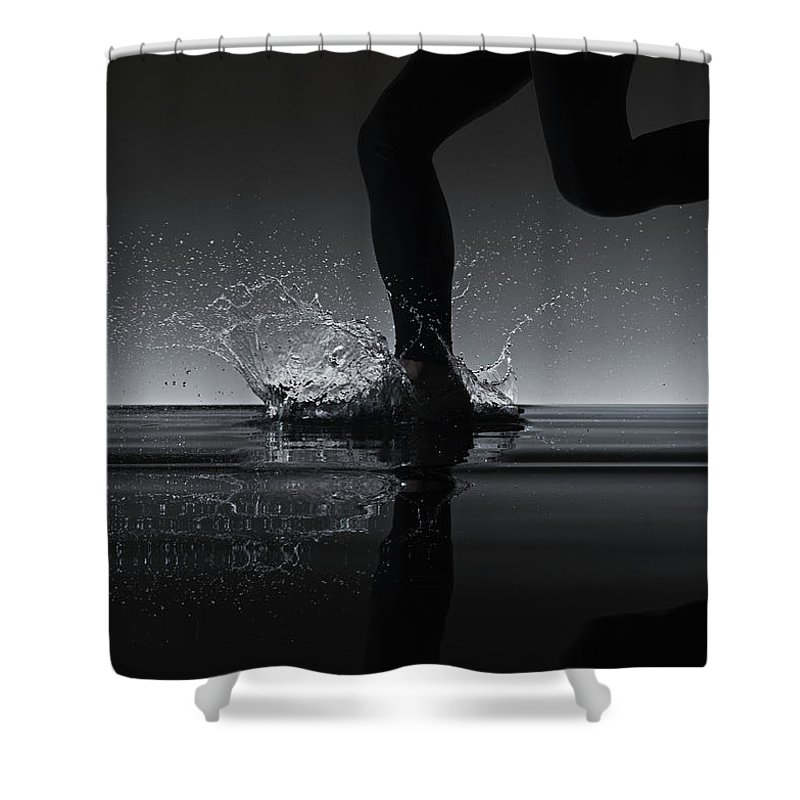 Recreational Pursuit Shower Curtain featuring the photograph Running Through Water by Jonathan Knowles