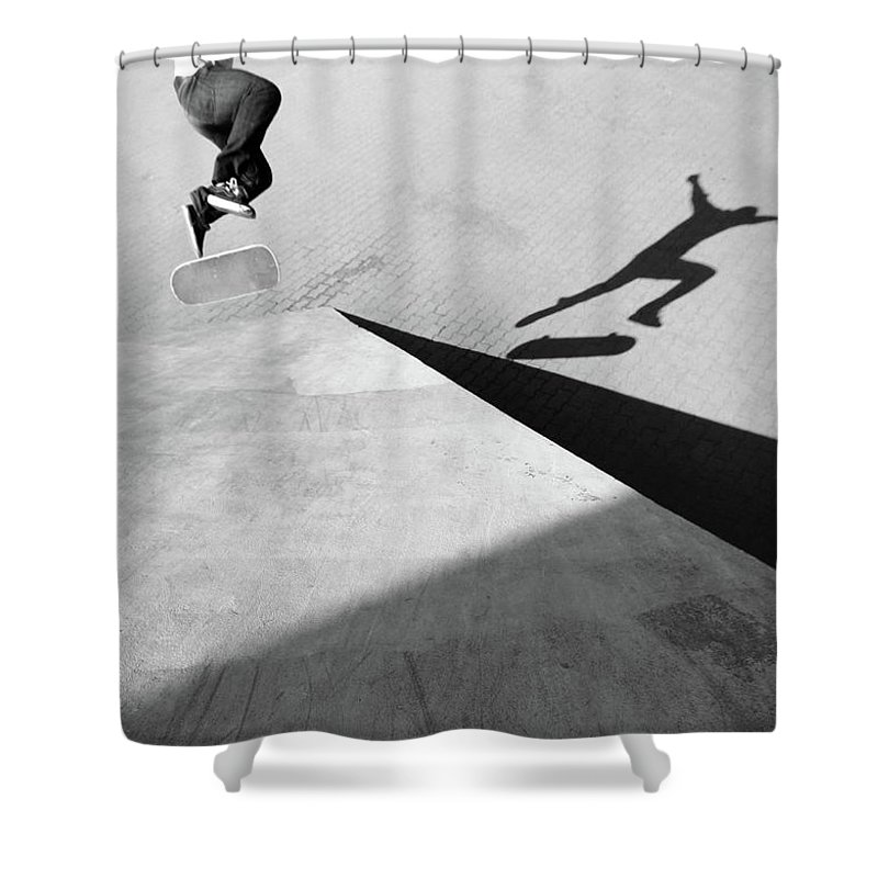 Shadow Shower Curtain featuring the photograph Shadow Of Skateboarder by Mgs
