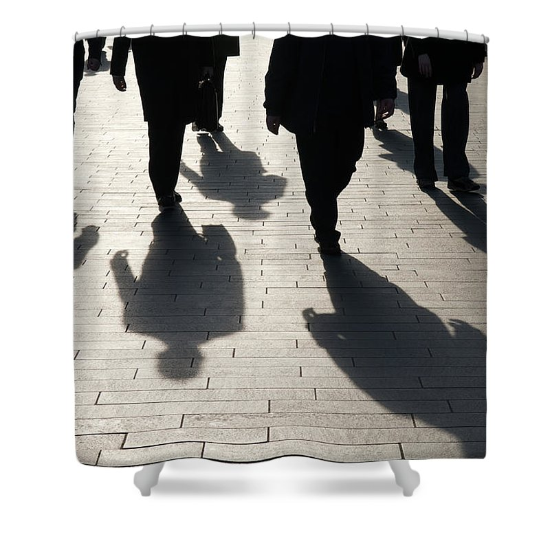 Shadow Shower Curtain featuring the photograph Shadow Team Of Commuters Walking On by Peskymonkey