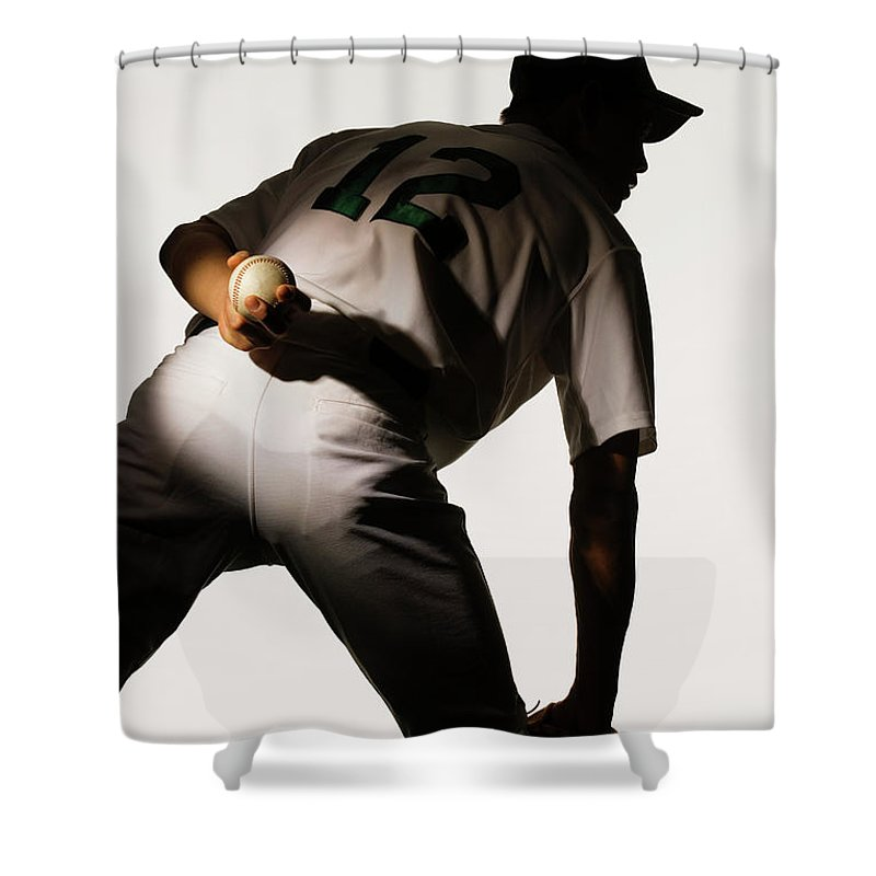 Three Quarter Length Shower Curtain featuring the photograph Silhouette Of Baseball Pitcher Holding by Pm Images