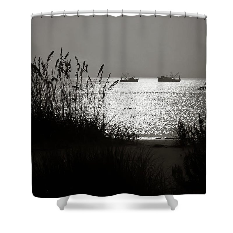 Tranquility Shower Curtain featuring the photograph Silhouettes Of Sea Oats And Shrimp Boats by Joseph Shields