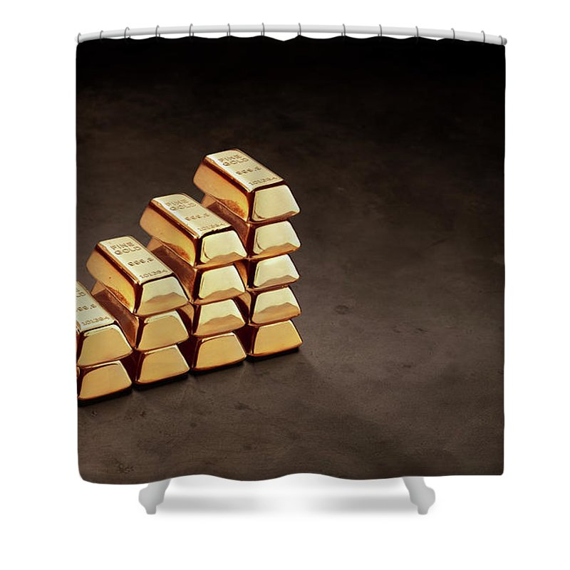 In A Row Shower Curtain featuring the photograph Stepped Stack Of Gold On Dark Surface by Anthony Bradshaw