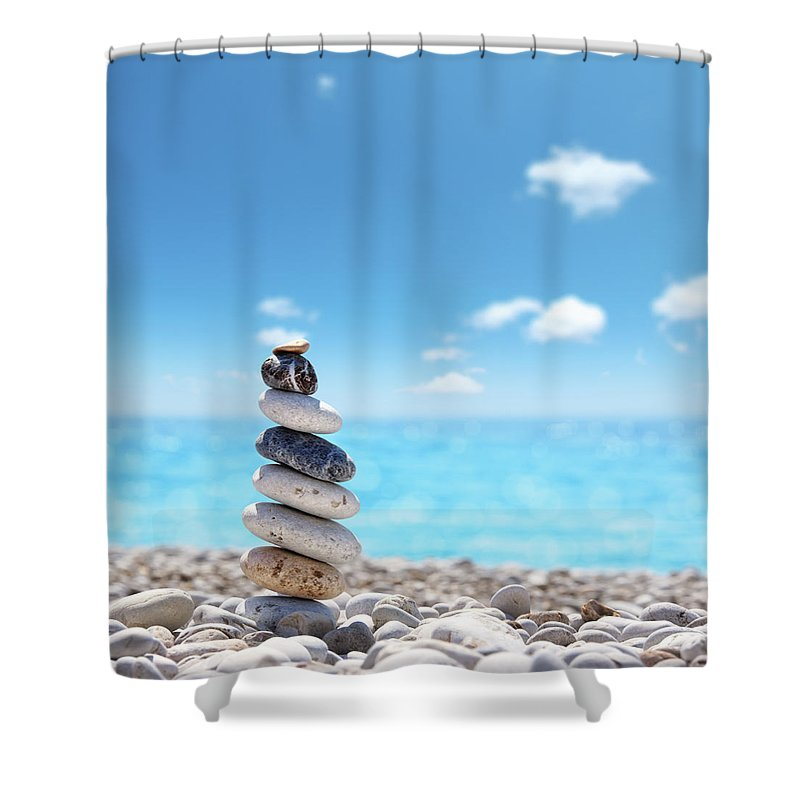 Water's Edge Shower Curtain featuring the photograph Stone Balance On Beach by Imagedepotpro