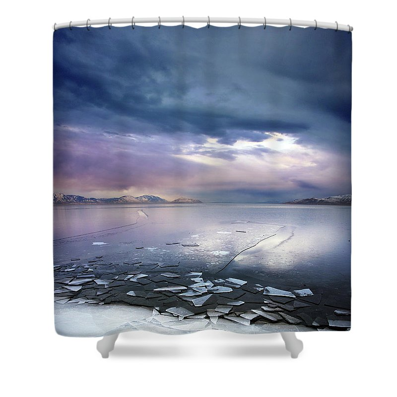 Scenics Shower Curtain featuring the photograph Storm Clouds Clearing Over Icy Lake by Utah-based Photographer Ryan Houston