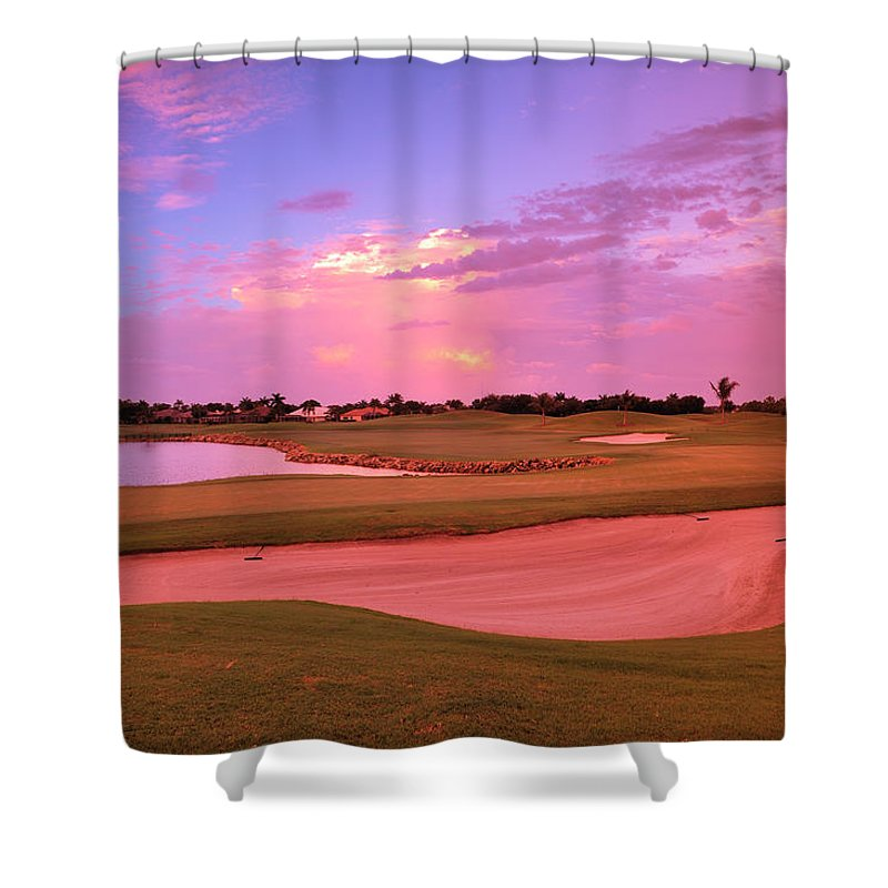 Sand Trap Shower Curtain featuring the photograph Sunrise View Of A Resort On A Golf by Rhz