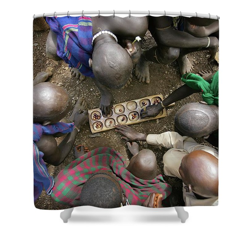 Nut Shower Curtain featuring the photograph Suri Tribal Game Of Mancala Seen From by Timothy Allen