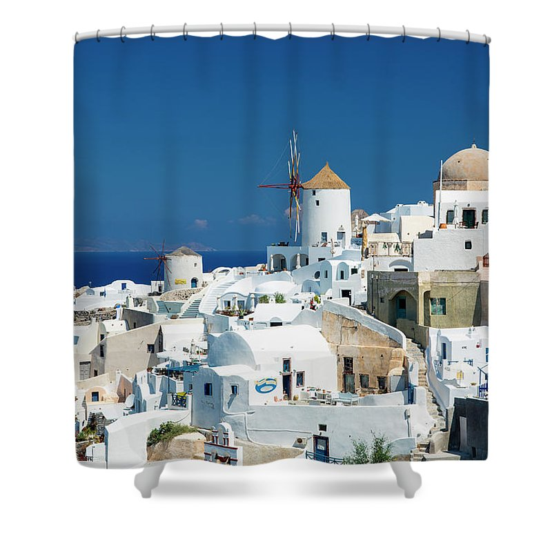 Greek Culture Shower Curtain featuring the photograph The Small Greek Village Of Oia by Sylvain Sonnet