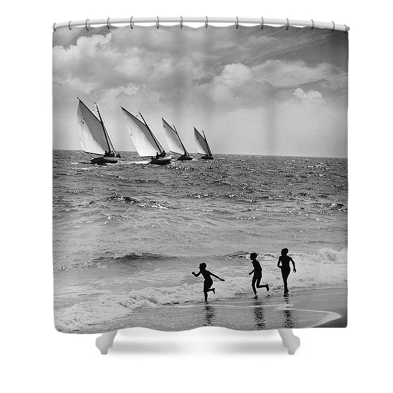 Following Shower Curtain featuring the photograph Three Boys Running Along Beach by Stockbyte
